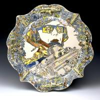 Woman combat troop holding machine gun looking into the distance, painted onto ornate ceramic serving plate.