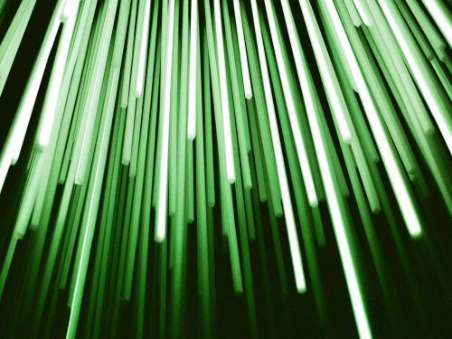 Horizontal photo of green light beams.