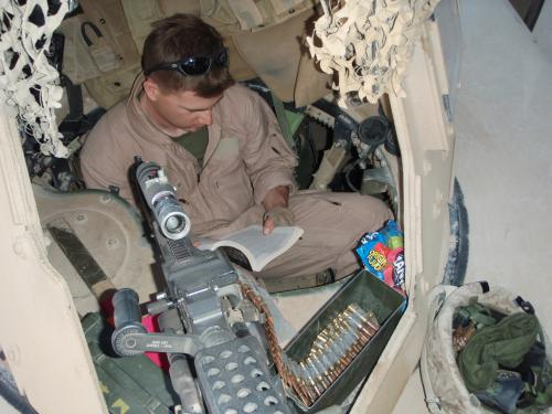 Cole Becher reads Ender's Game in a turret while stationed in Iraq