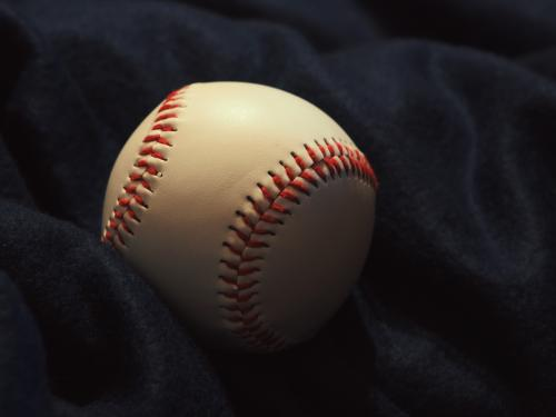 Horizontal close up of a baseball.