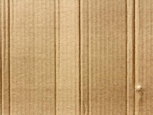 Horizontal photo of a cardboard sheet.
