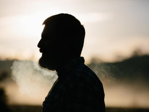 Horizontal photo of a man's profile that is also a silhouette.