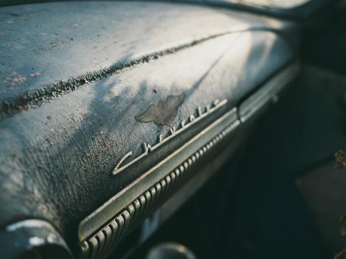 Horizontal photo of a worn dash board of a Chevrolet.