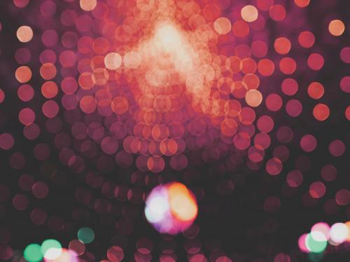 A pink disco ball out of focus