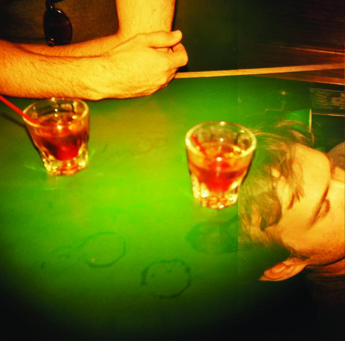 Two drinks on a pool table with man's head. Photo courtesy of Annie DeWitt